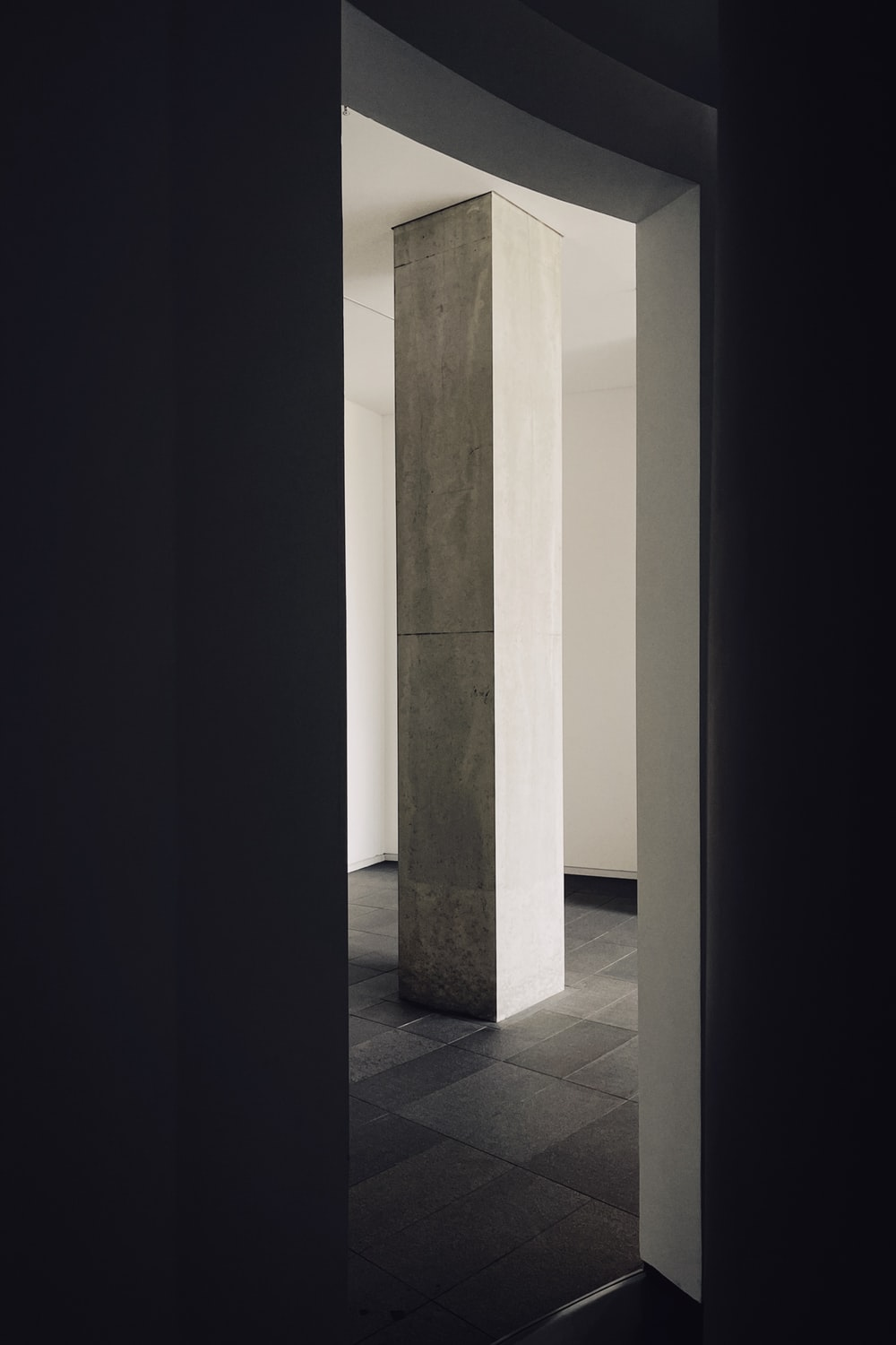 white and gray tiled hallway
