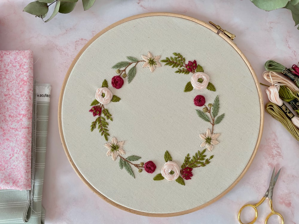 white and red floral round plate