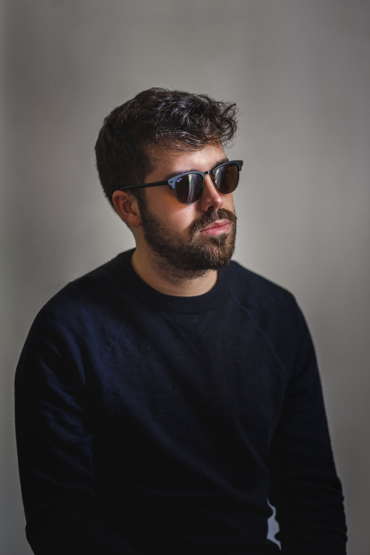 man in black crew neck shirt wearing black sunglasses