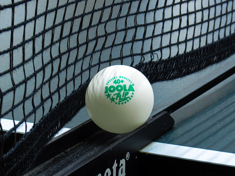 white golf ball on black and white textile