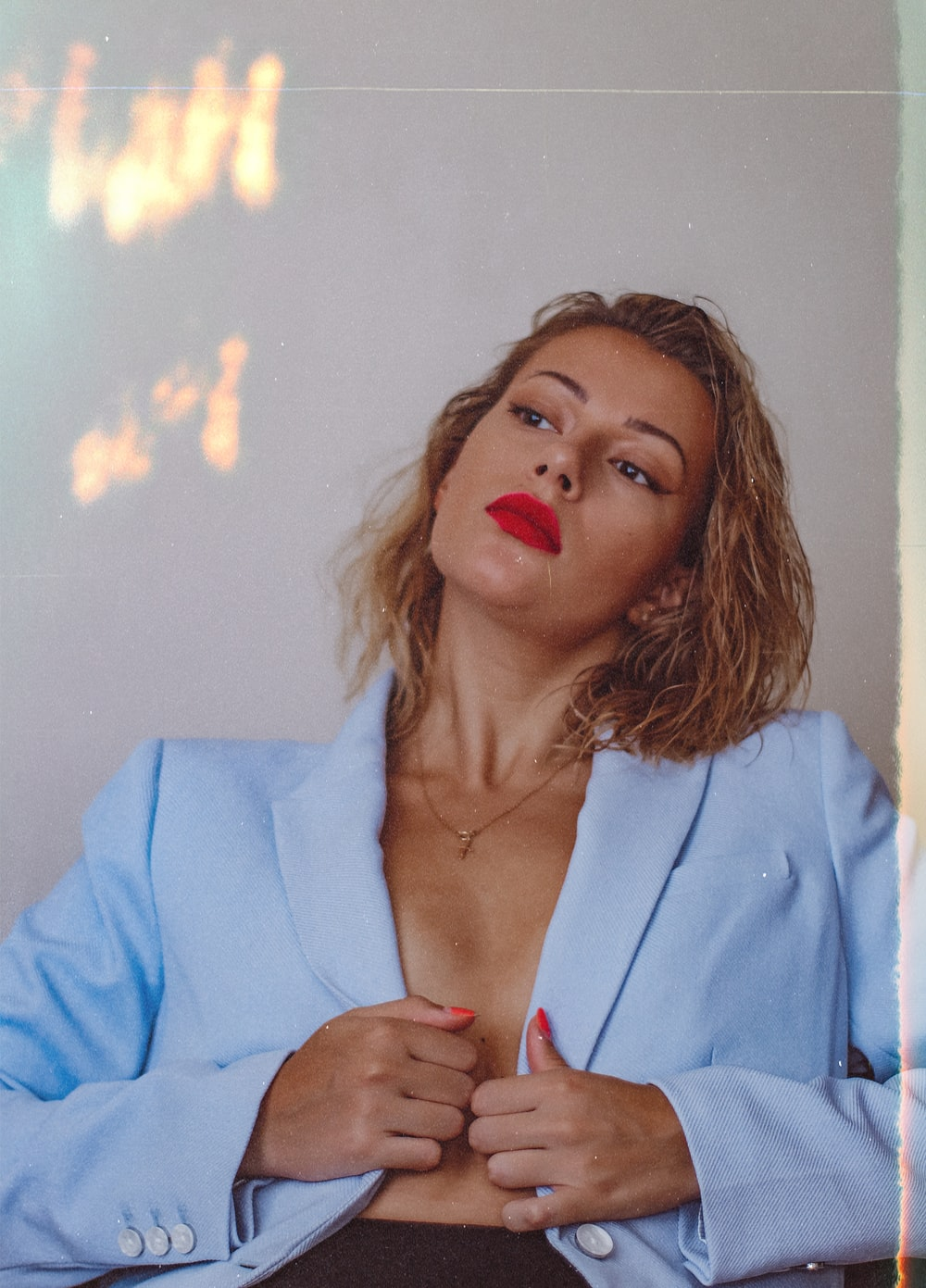 woman in blue blazer with red lipstick