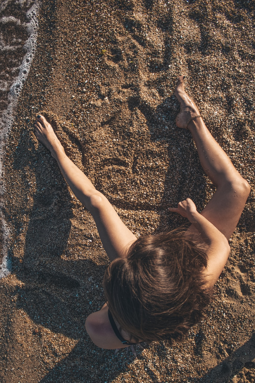 girl in black shirt on brown sand during daytime