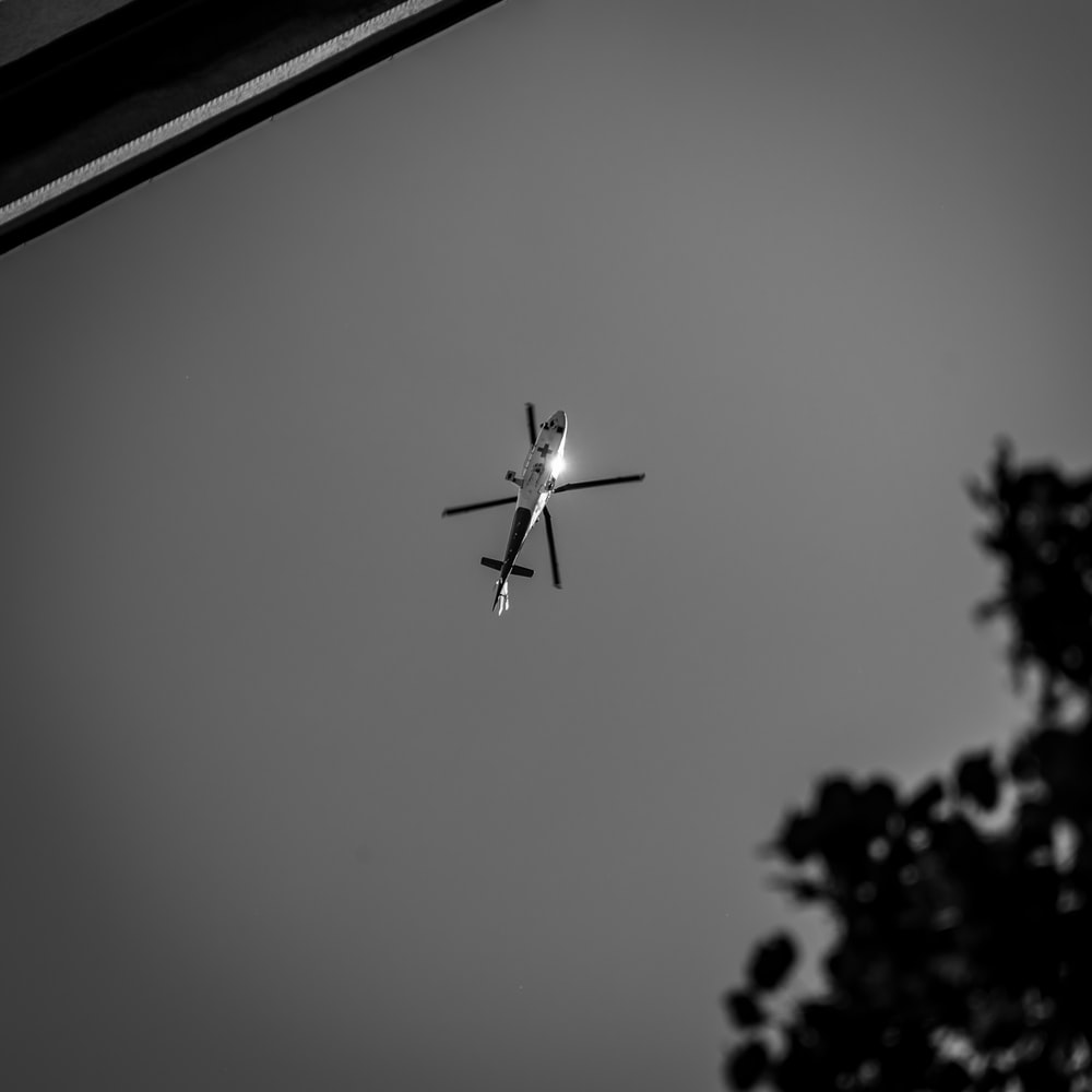 grayscale photo of a plane in the sky