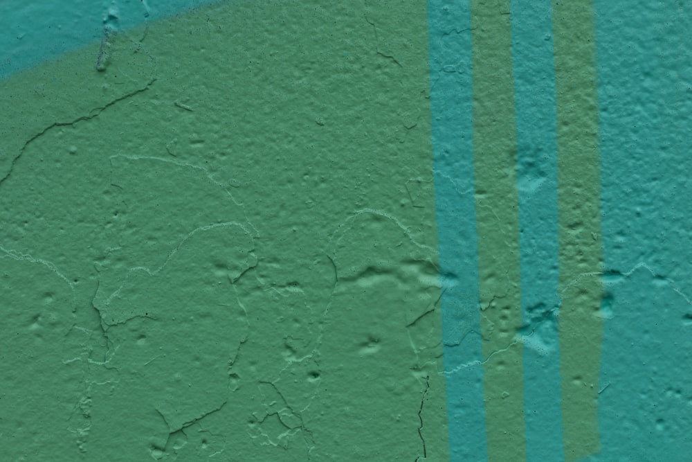 blue concrete wall during daytime