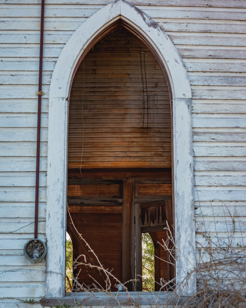 brown wooden door with white wooden frame