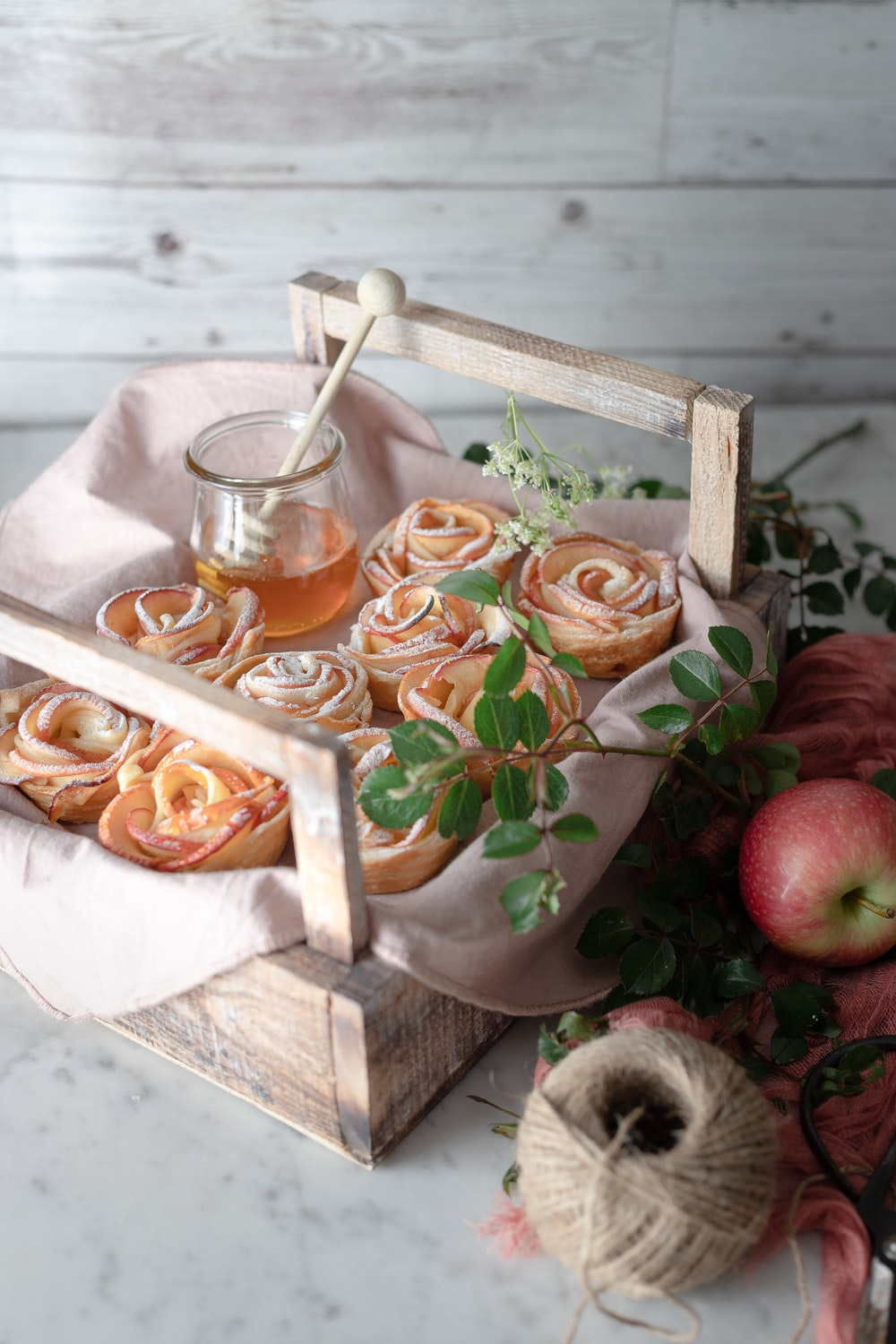 red apples on brown wooden tray