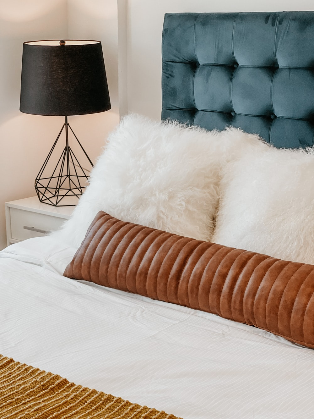 white fur textile on white bed
