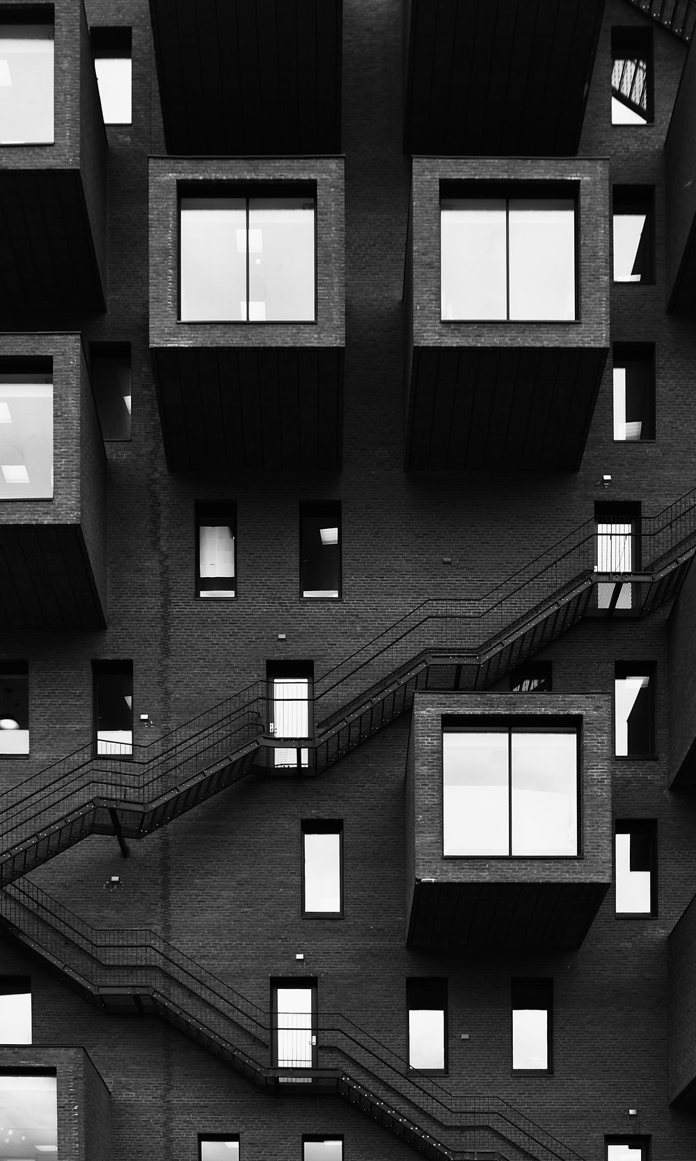 grayscale photo of building with windows