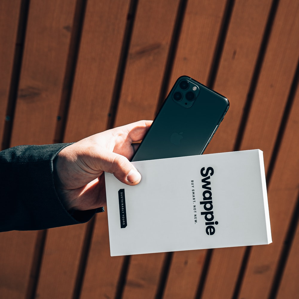 person holding white and black card