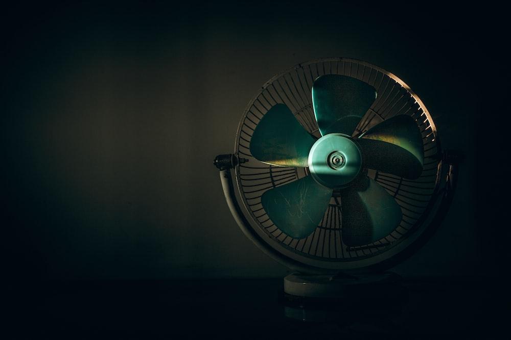 black and green desk fan