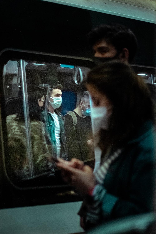 woman in black jacket sitting on bus seat