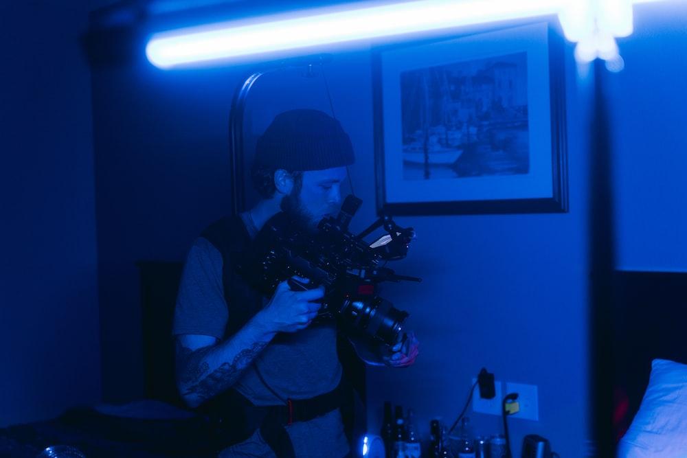 man in black t-shirt playing video game