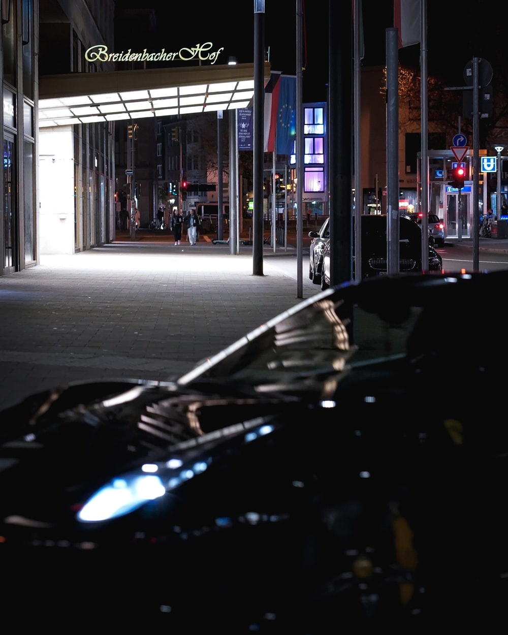 black car parked near building during night time