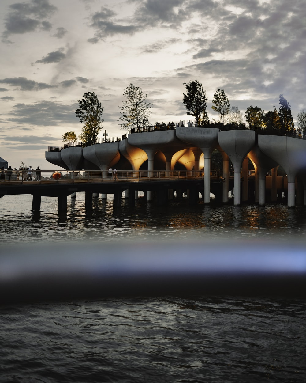 brown concrete bridge over water