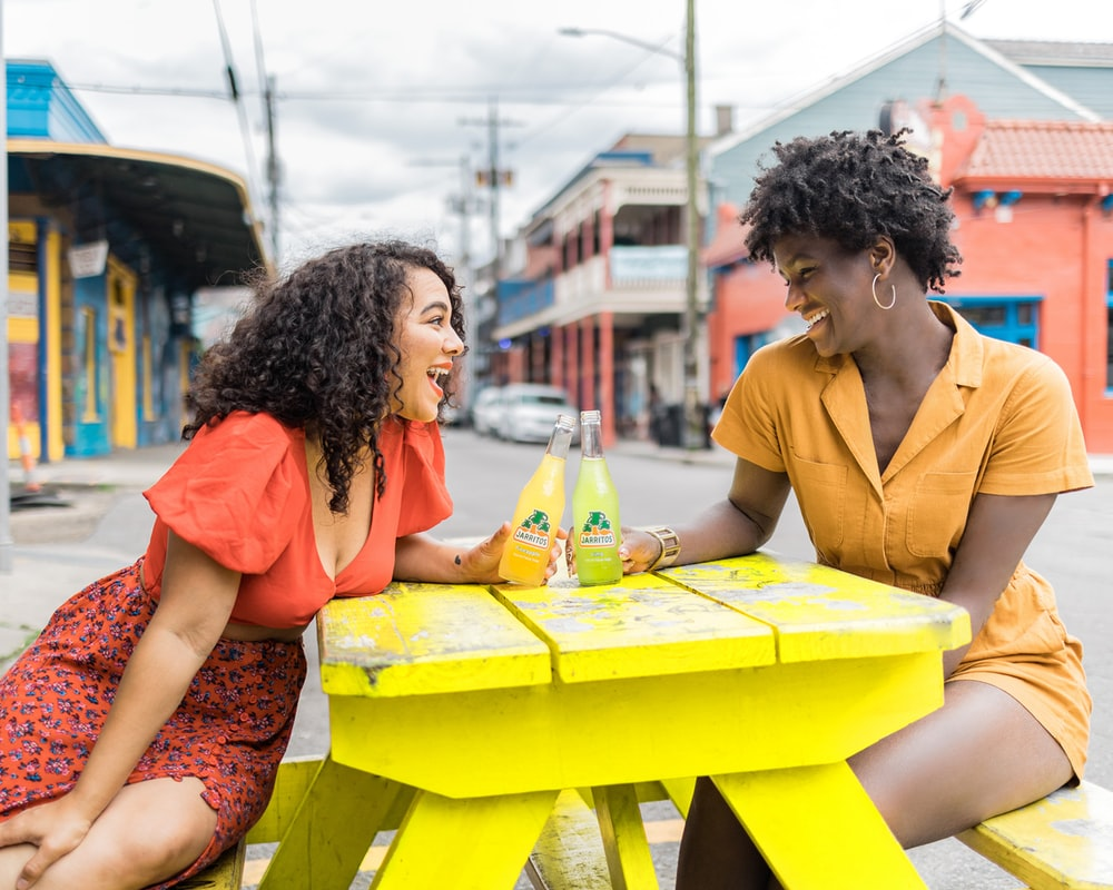 man and woman sitting on chair in front of table with yellow table cloth
