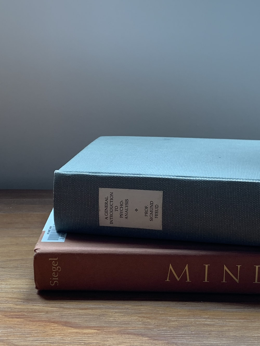 blue and red book on brown wooden table