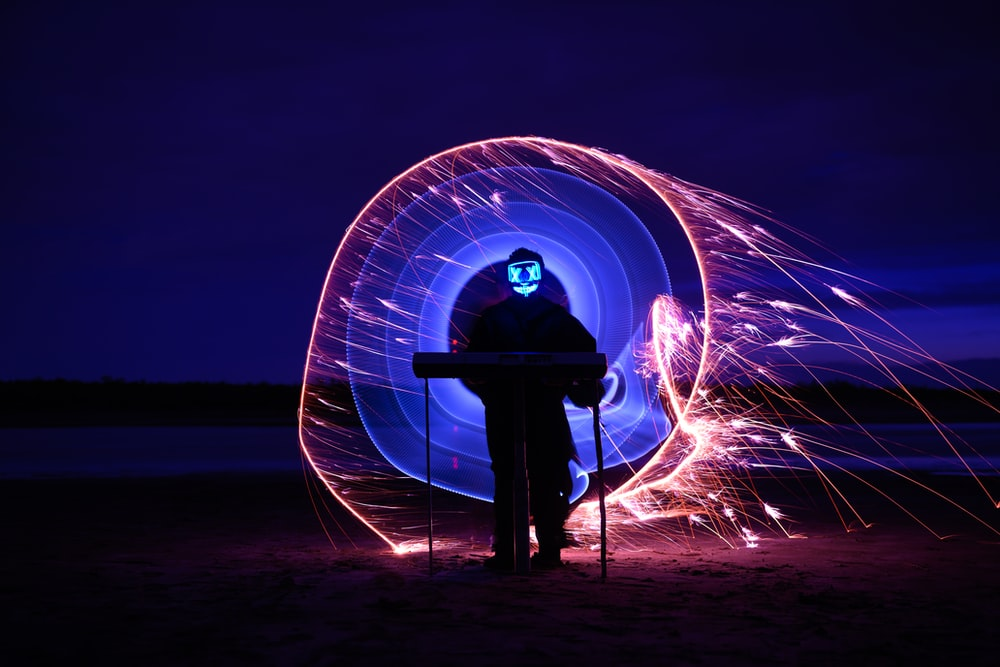 man standing on a steel wool photography
