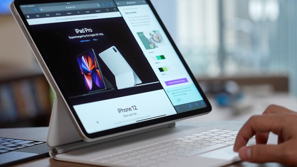 black samsung galaxy smartphone on white laptop computer