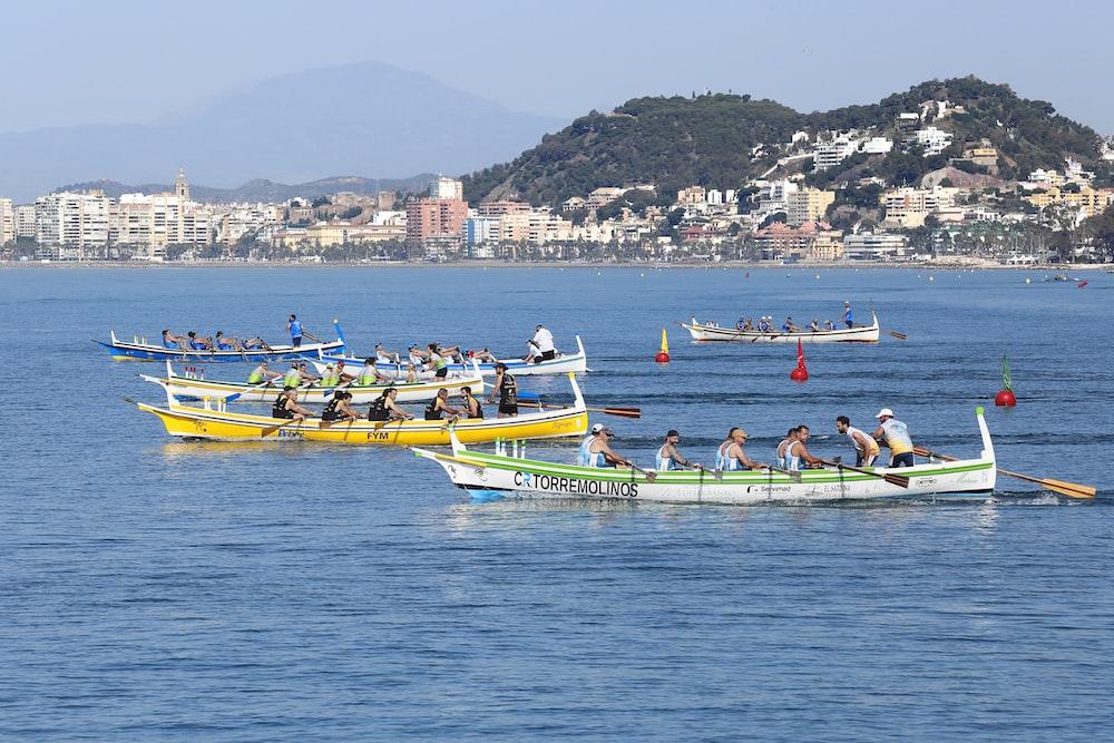 people riding on yellow kayak on sea during daytime