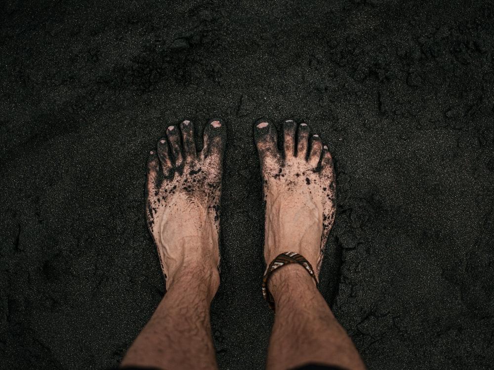 person with black nail polish