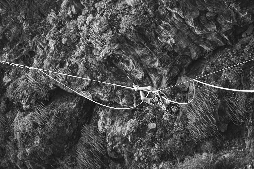 grayscale photo of a hanging bridge