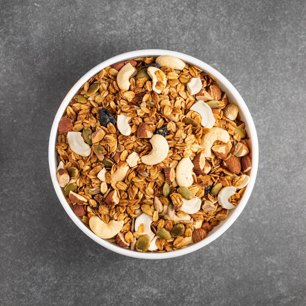 brown peanuts in white ceramic bowl
