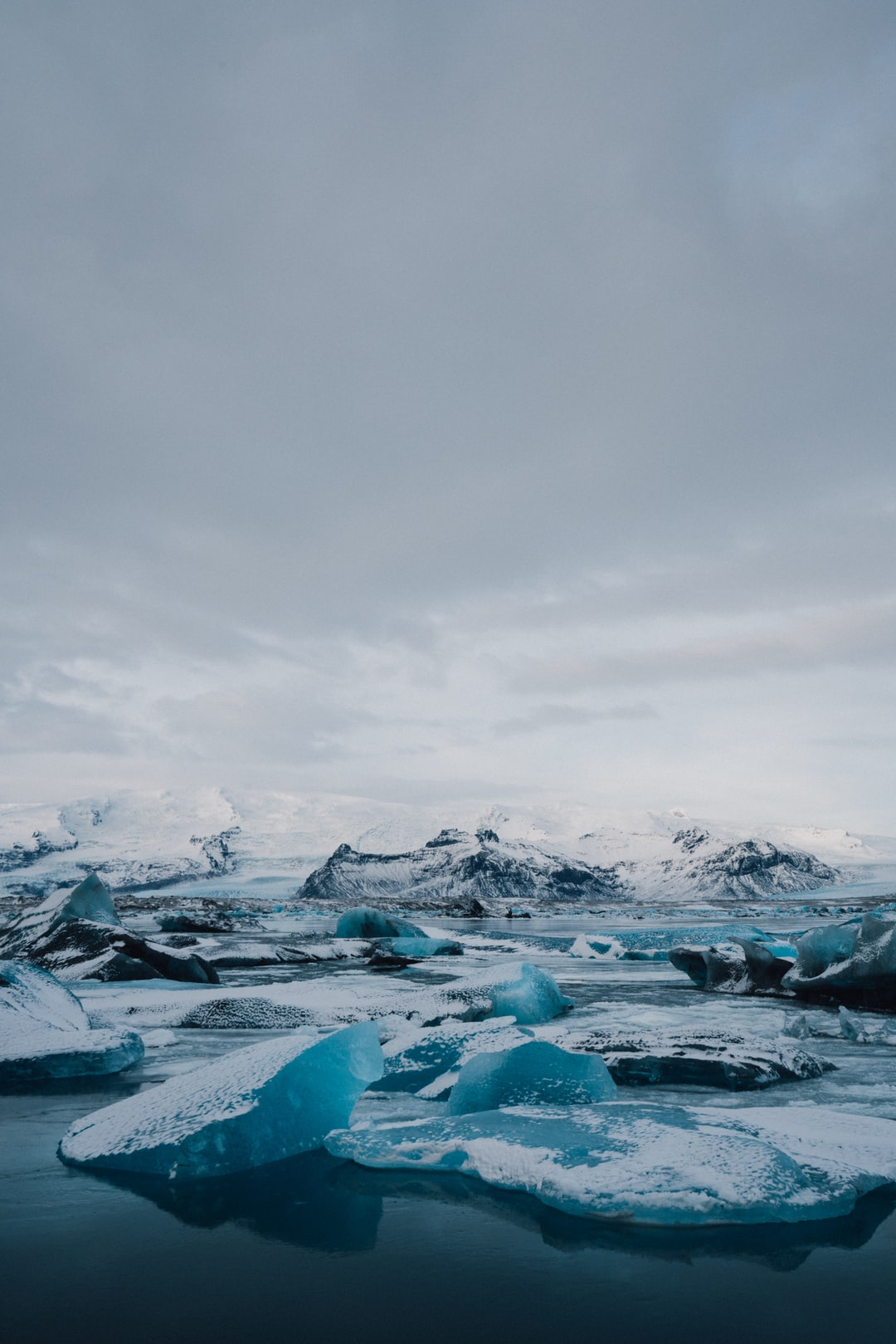 ice on body of water under cloudy sky