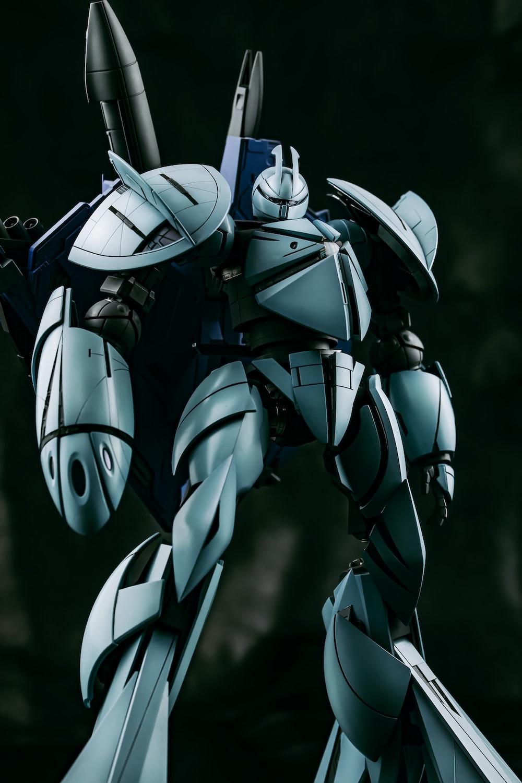 gray robot in gray suit