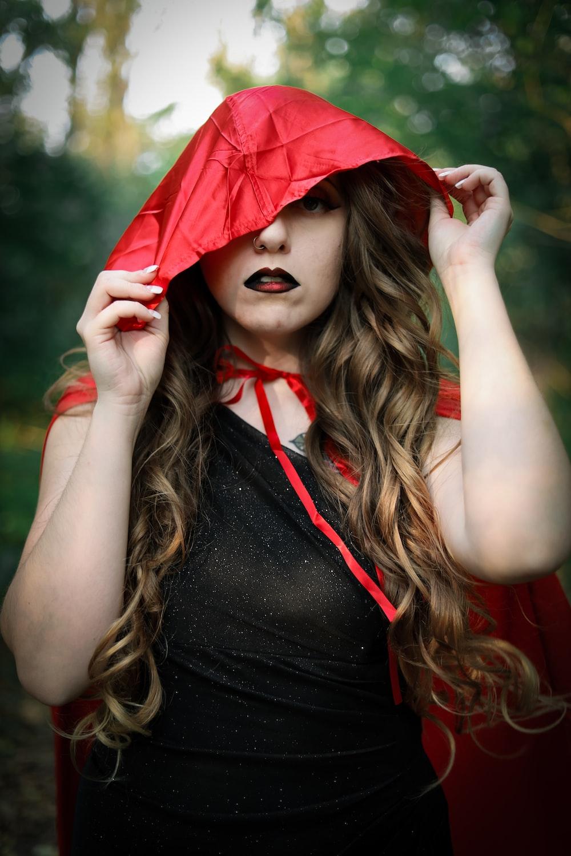woman in black tank top wearing red hat