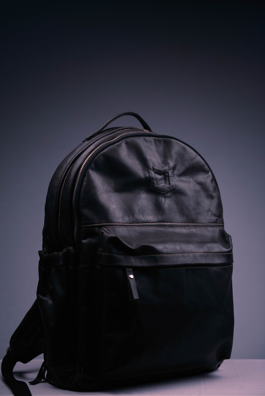 black nike backpack on purple surface