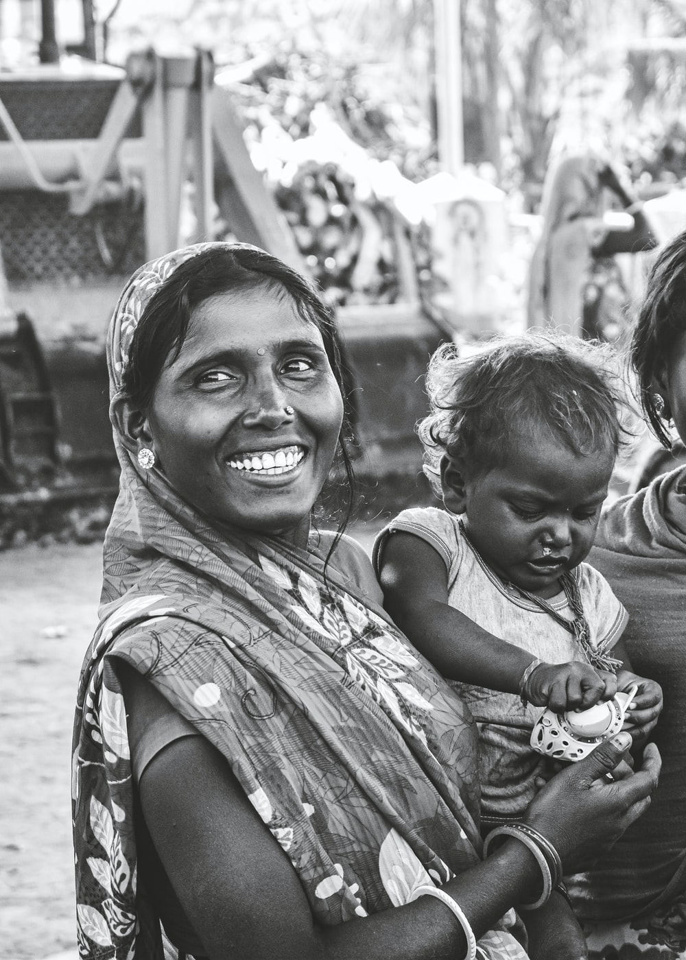 grayscale photo of woman carrying child