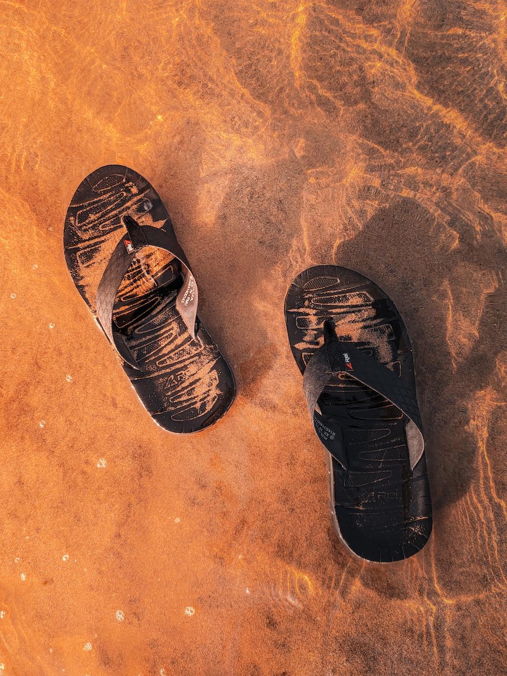 black and brown flip flops