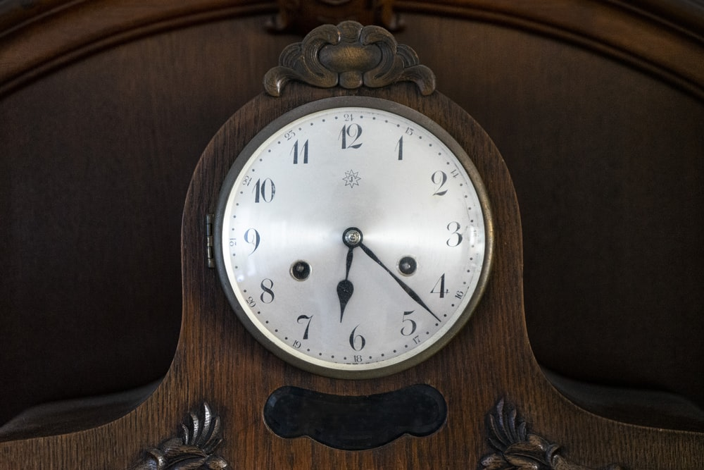 brown wooden framed analog wall clock