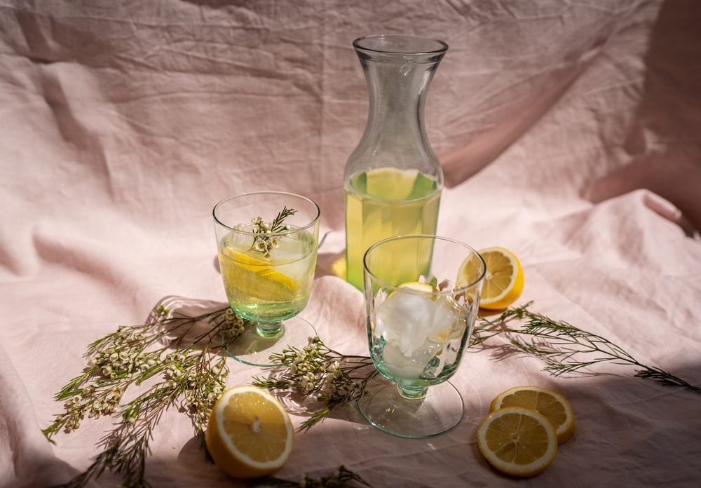 clear glass pitcher with lemon juice