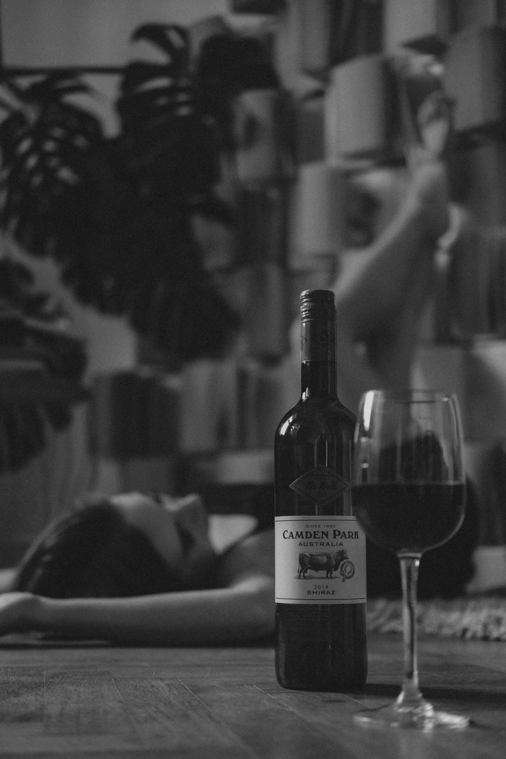 grayscale photo of wine bottle and wine glass