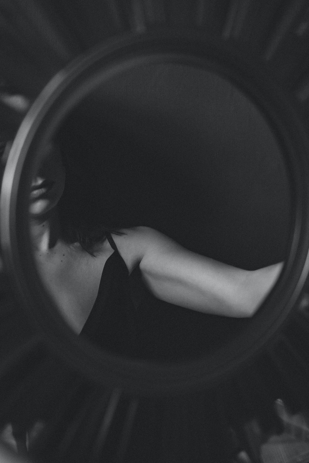 grayscale photo of woman in black brassiere