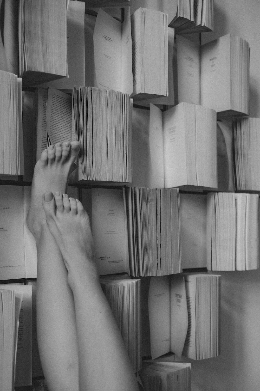 persons feet on brown cardboard box