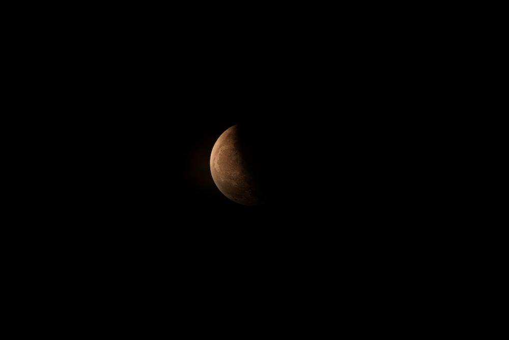 brown moon in dark room