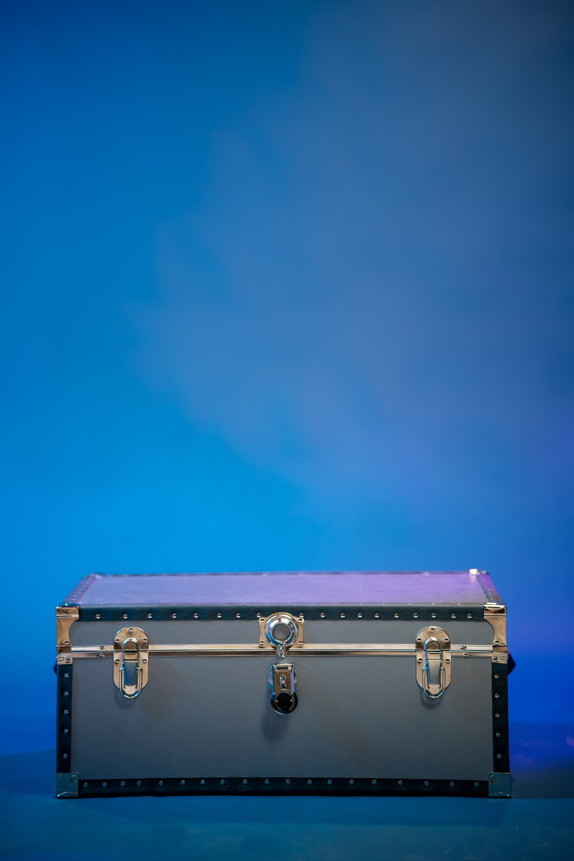 gray suitcase under blue sky