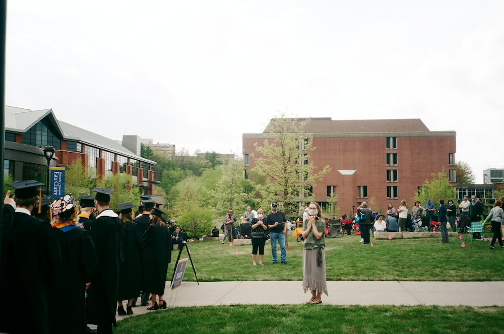 people standing on green grass field during daytime