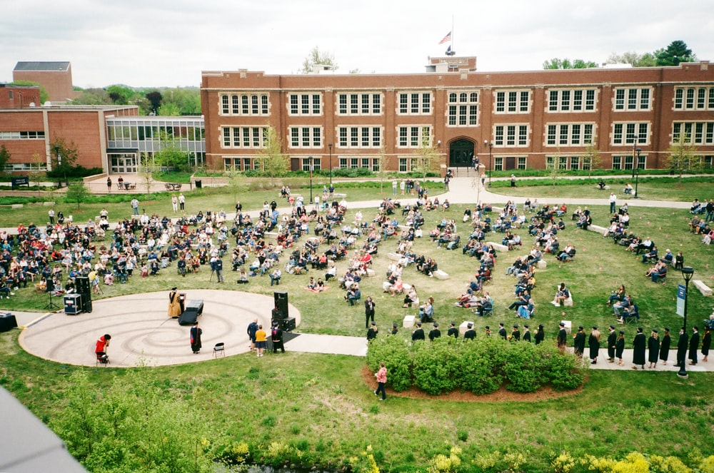 people in front of brown building during daytime