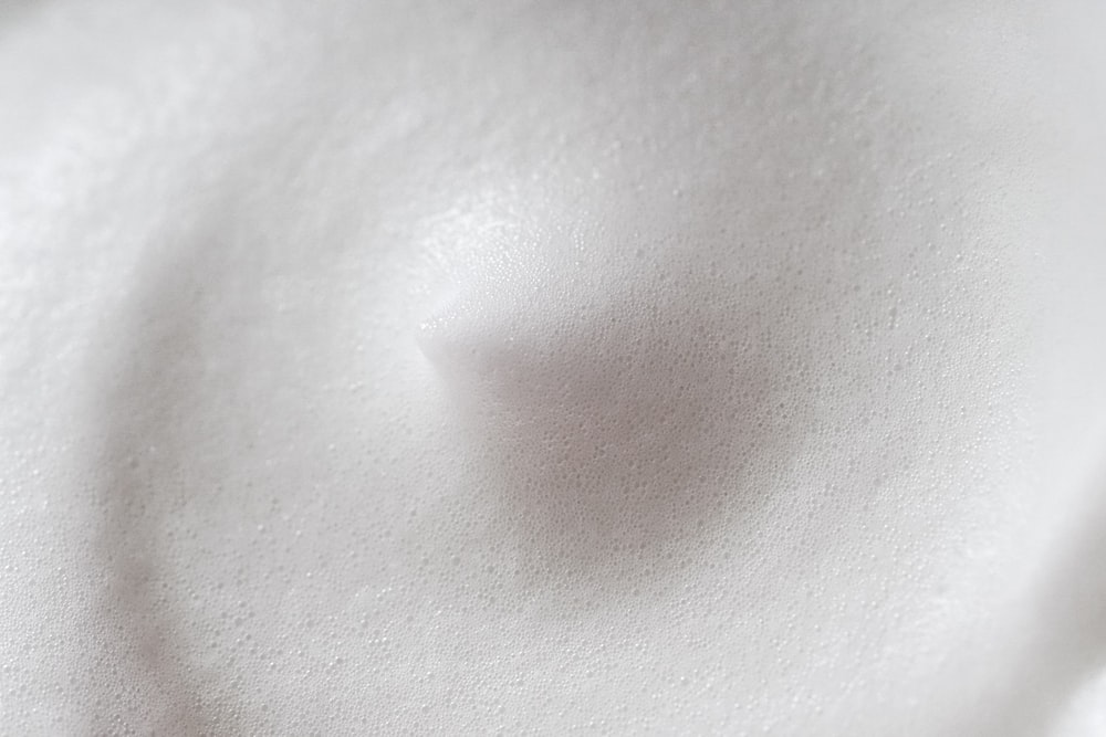 persons belly button and white textile