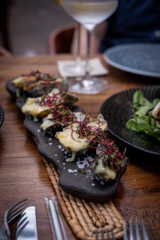 vegetable salad on black ceramic plate
