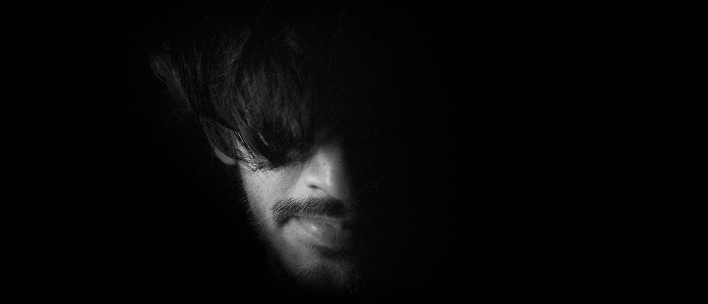 mans face in black background
