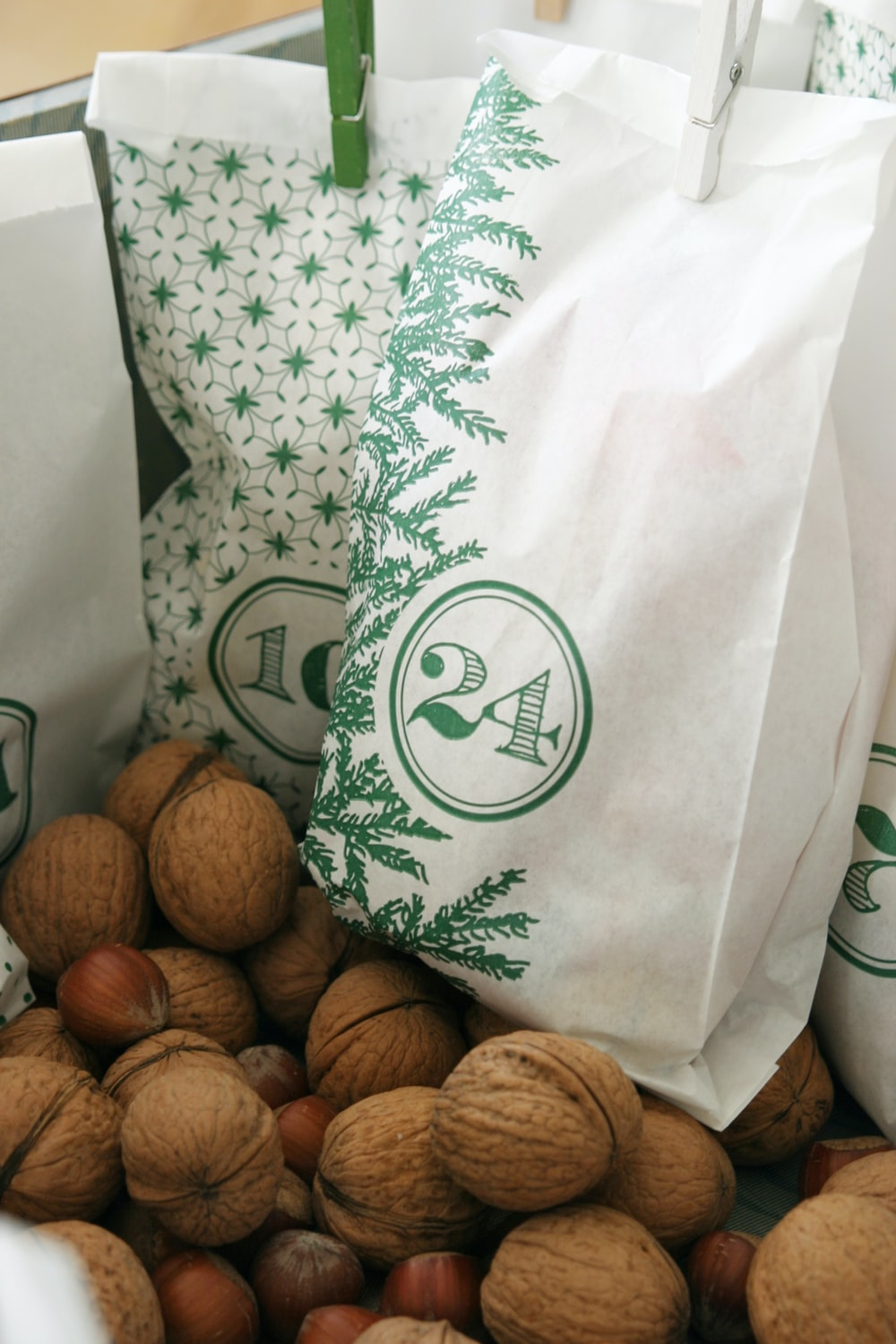 brown round fruits on white plastic bag