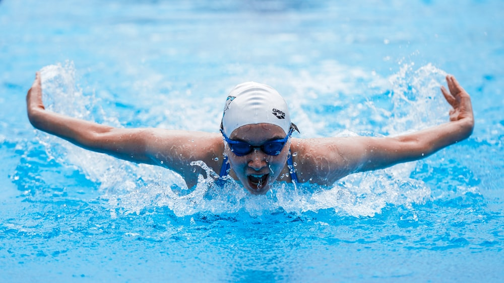 person in swimming goggles in water