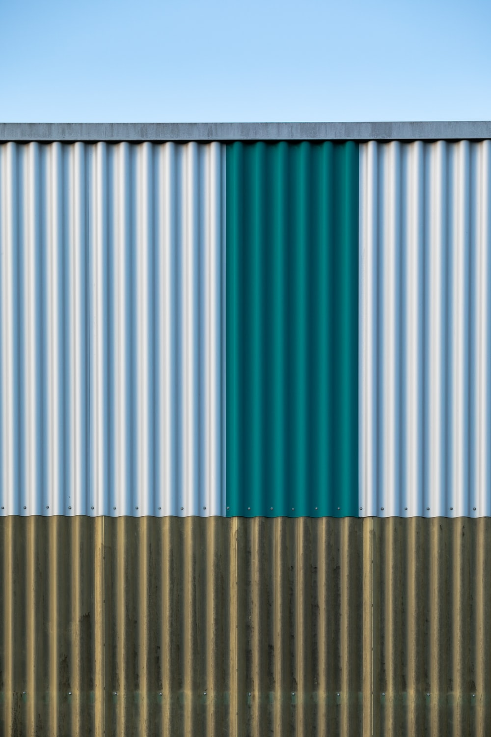 white blue and green striped textile