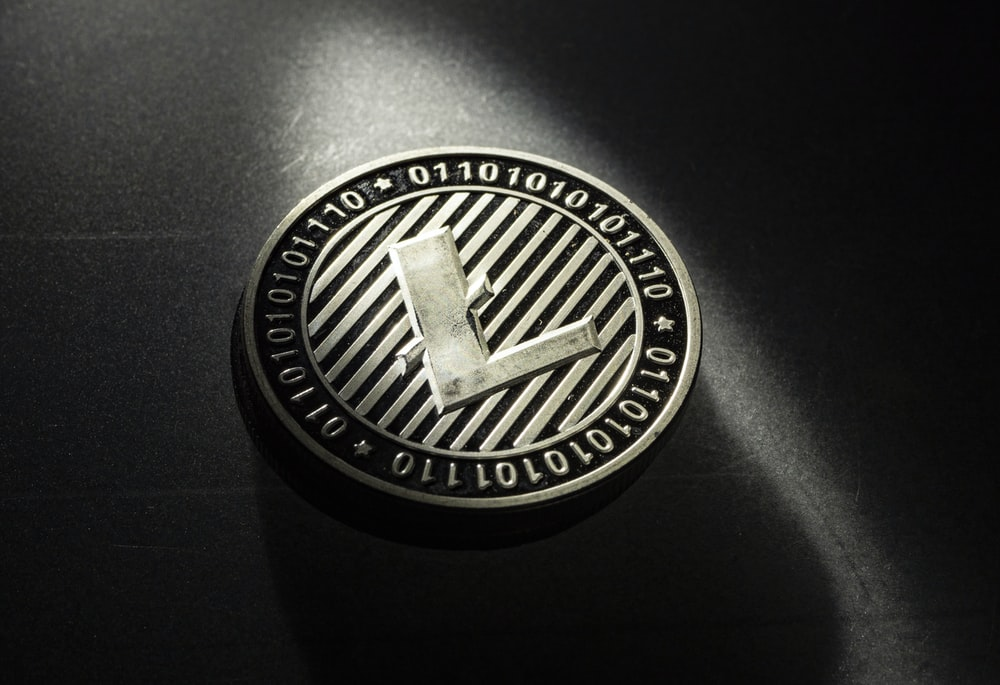 black and silver round logo
