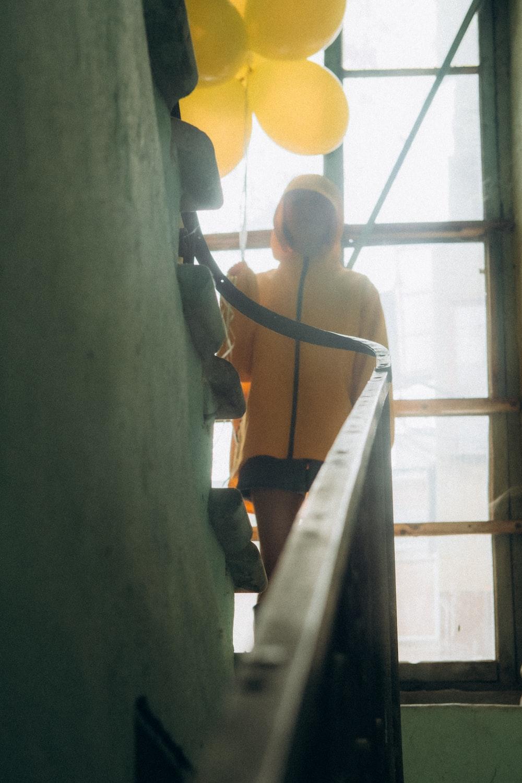 woman in orange bikini standing on stairs