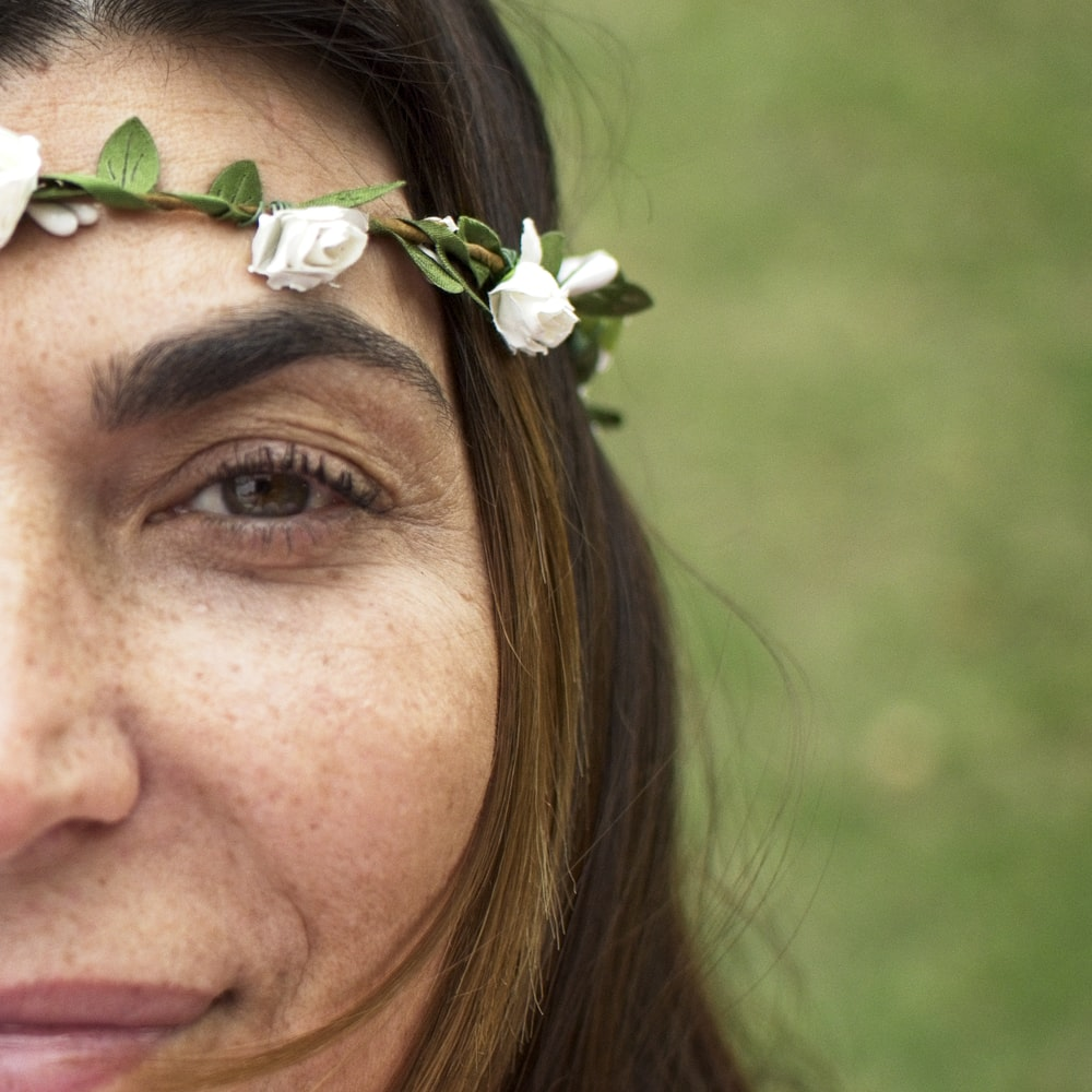 woman with white flower on ear